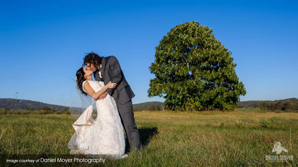 Wedding kiss by Daniel Moyer Photography at Historic Valley View Farm